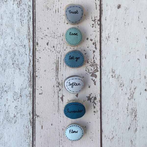 Let go and trust meditation painted pebbles