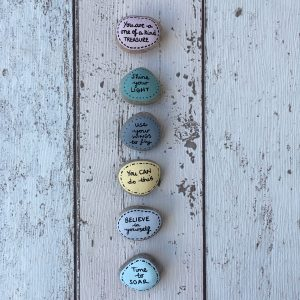You can do this hand painted affirmation pebbles